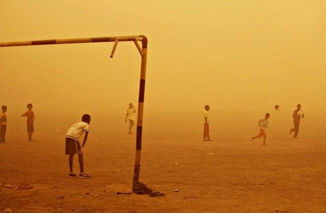 800px-Sudanese_kids_playing_Football